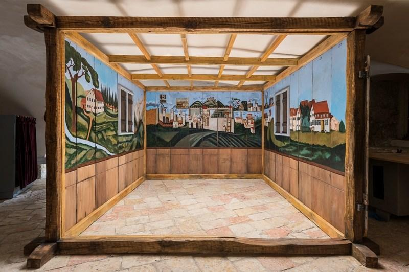an unauthorized, meticulous replica of a painted wooden sukkah from Germany, was smuggled to British Mandate Palestine at the outbreak of WWII, and recreated in the basement of Jerusalem's former leper colony.